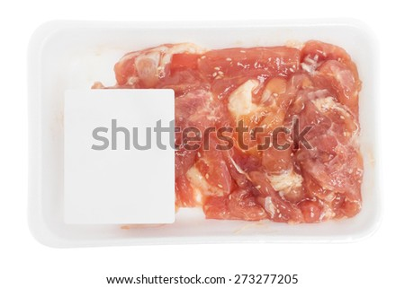 raw pork in Styrofoam package on white