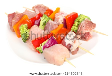 Raw pork kebab isolated on white - stock photo