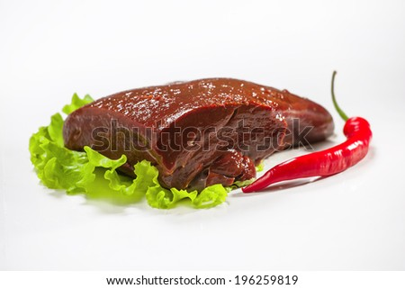 Raw pork liver isolated on white background. Salad and pepper - stock photo
