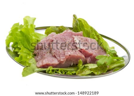 Raw pork meat with herbs and spices