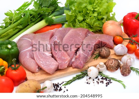 Raw pork ready to be cooked isolated on white - stock photo