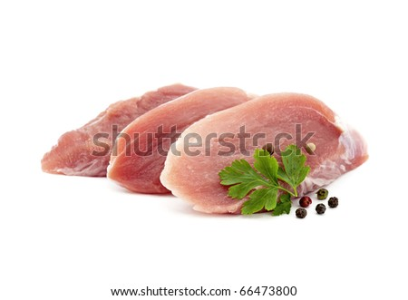 Raw pork with parsley and pepper - stock photo