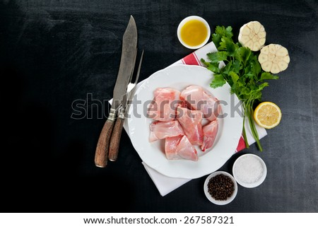 raw rabbit meat with cooking ingredients - stock photo