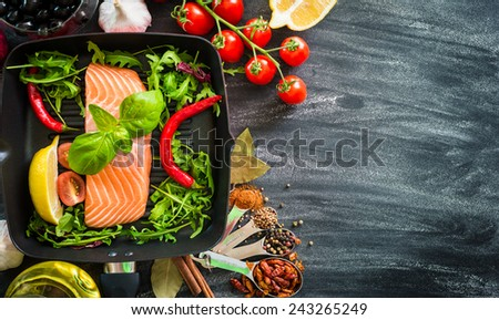 raw red fish with vegetables - stock photo
