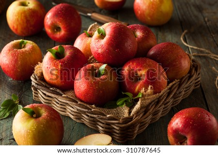 Raw Red Fuji Apples in a Basket - stock photo