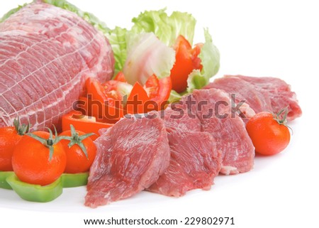 raw red meat with salad on white background - stock photo