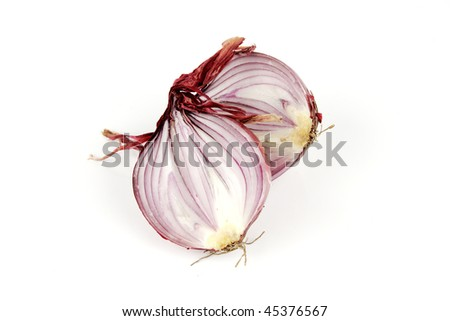 Raw red onion cut in half on a reflective white background - stock photo