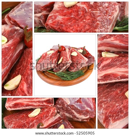 raw ribs served with greenery on wooden plate - stock photo