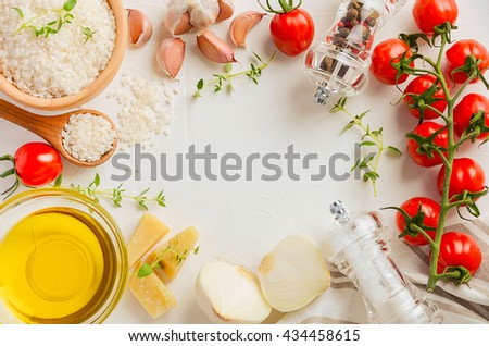 Raw rice and ingredients for cooking risotto, top view, copy space - stock photo