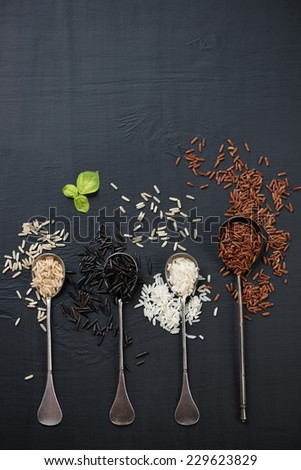 Raw rice kernels of different types, above view, studio shot - stock photo