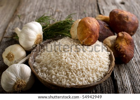 raw rice on bowl with cep - stock photo