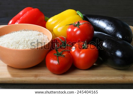 Raw rice  with fresh vegetable for cooking - stock photo