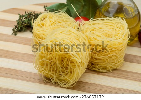 Raw Round vermicelli on the wood background - stock photo