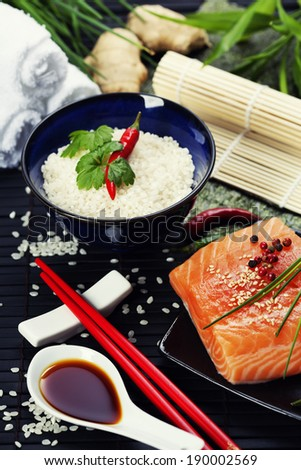 raw salmon filet with other sushi ingredients - stock photo