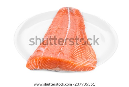 Raw salmon fillet on plate. Isolated on a white background.