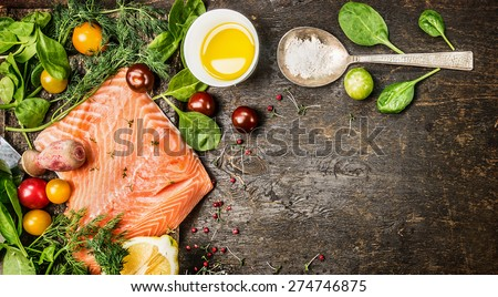 Raw salmon fish fillet with spoon of salt, fresh herbs and spices on rustic wooden background, top view, banner for website with cooking concept. - stock photo