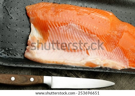 raw salmon on a black background