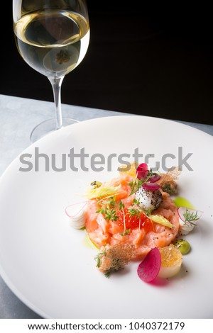 Raw salmon salad with herbs and spices