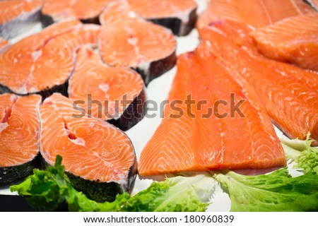 Raw salmon steaks and fillets on the ice - stock photo