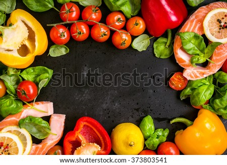 Raw salmon steaks and fresh ingredients for cooking on a dark background. Banner, frame, menu. Healthy and diet food concept. Space for text. Top view - stock photo