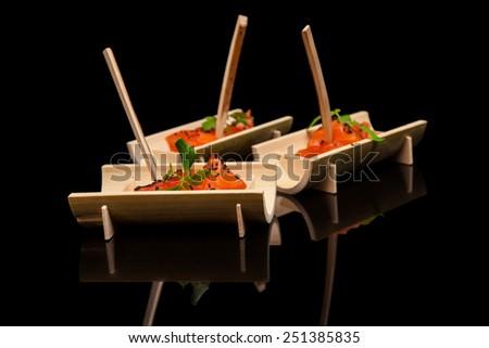 Raw salmon sushi meat cubes on  black background. - stock photo