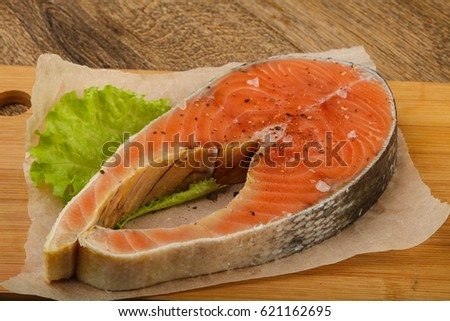Raw salmon with salt and pepper ready for cooking