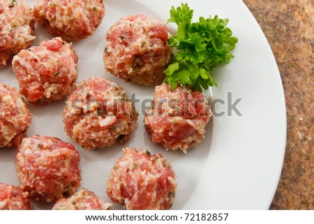 Raw sausage meatballs are ready to cook.