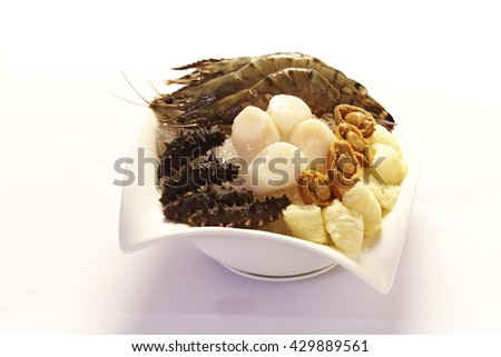 Raw Sea Cucumber ,scallop,abalone and prawn on ice in a bowl,food ingredient. - stock photo
