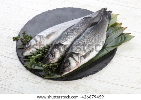 Raw seabass fish with thyme and rosemary