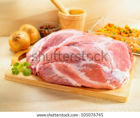 Raw Shoulder Square Cut on a cutting board - stock photo
