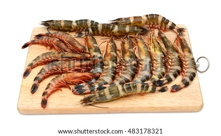 raw shrimps on cutting board isolated on white