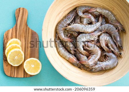 Raw shrimps prepared to cook - stock photo