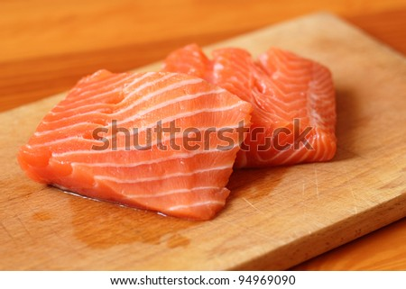 Raw Siberian Salmon Fillet on cutting board (soft focus)