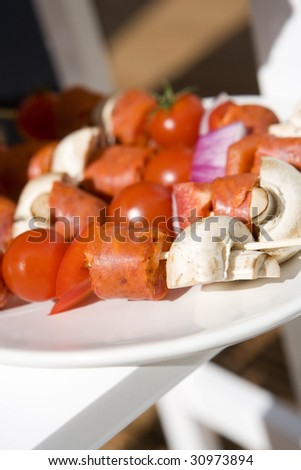 Raw skewers on a plate