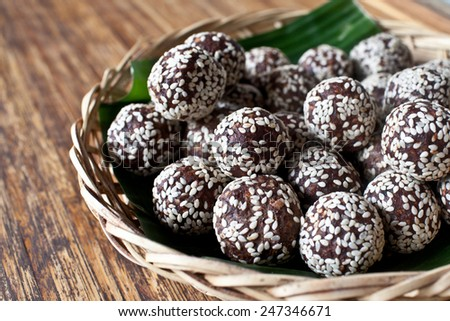 Raw snack balls, mixed healthy nuts and dried fruits with sesame seeds - stock photo