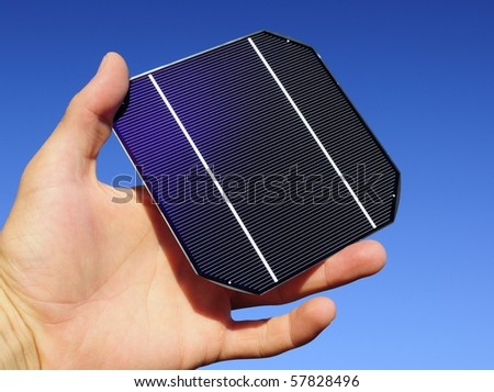 Raw solar cell in a hand - stock photo