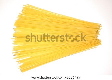 Raw spaghetti on a white background - stock photo