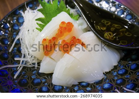 raw squid and salmon eggs - stock photo