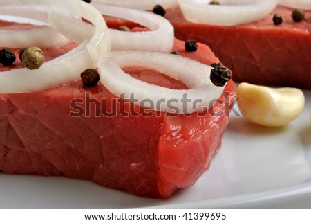 raw steak meat with some organic onion