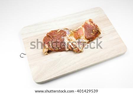 raw steak on wooden on white background - stock photo