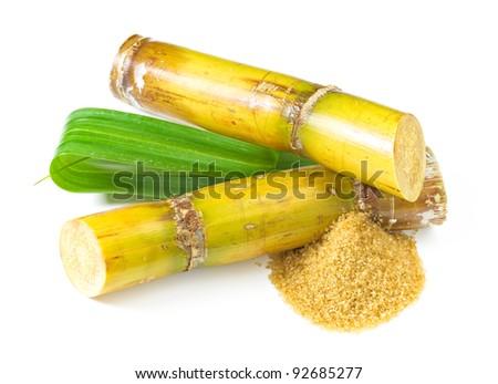 Raw sugar isolated on white - stock photo