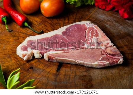 raw T-bone Steak - stock photo