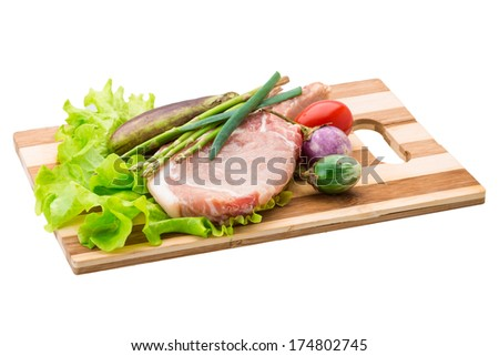 Raw t-bone steak with asparagus and egg-plant - stock photo
