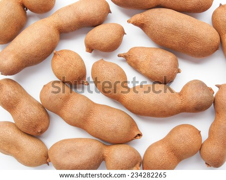 Raw tamarind fruits (tamar hindi - Tamarindus indica) - stock photo