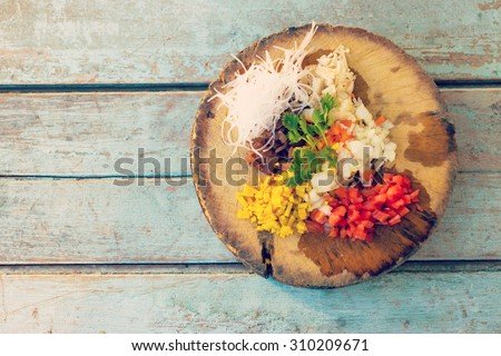 Raw Thai food on the wooden board.- Instagram filter - stock photo