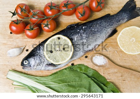 raw trout on a kitchen board - stock photo