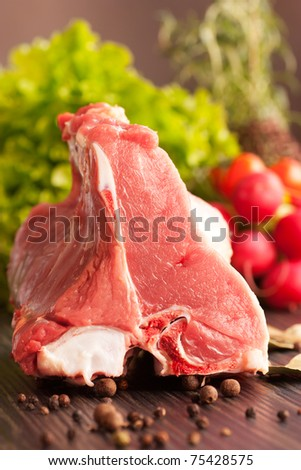 Raw veal meat with fresh vegetables and rosemary - stock photo