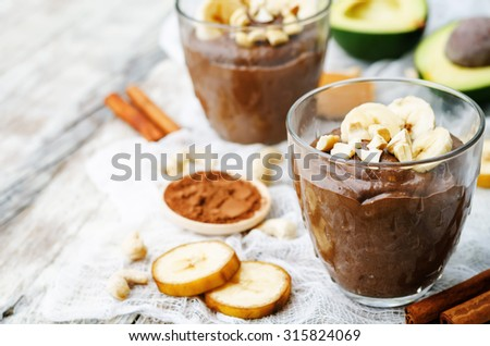 raw vegan avocado banana chocolate pudding. the toning. selective focus - stock photo