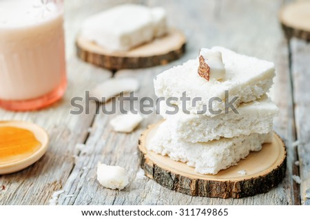 raw vegan coconut bars on a white wood background. the toning. selective focus - stock photo