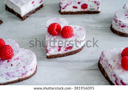 Raw Vegan Raspberry Coconut Cheesecake Bites, Selective Focus/ Close up/ Healthy Eating Concept - stock photo